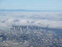 Downtown San Francisco aerial view taken from an airplane as fog Royalty Free Stock Photos