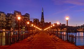 Downtown San Francisco pier. Downtown and the Transamerica Pyramid from Pier 7 in San Francisco, California at twilight Stock Photography