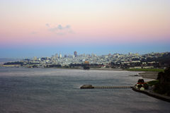 Downtown San Francisco after sunset as seen from the Golden Gate. Bridge Stock Photo