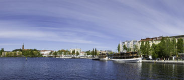 Downtown Savonlinna. Savonlinna, Finland. May 30, 2015. Panoramic view of the center of Savonlinna on sunny day with people enjoying the warm weather Royalty Free Stock Photography