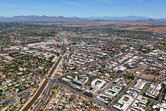 Downtown Scottsdale, Arizona. Aerial view of downtown Scottsdale, Arizona looking to the northeast with the McDowell Mountains and Four Peaks on the horizon stock photo