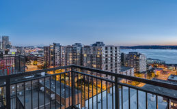 Downtown Seattle at the Blue Hour. Downtown Seattle and Puget Sound Shine at the Blue Hour from Balcony Royalty Free Stock Photo