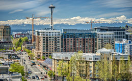 Downtown Seattle with Olympic Mountains. Seattle Condominiums, Denny Way, and the Space Needle Shine in front of the Olympic Mountains on a Sunny Summer Royalty Free Stock Images