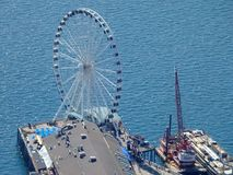 Aerial view of Ferris Wheel at end of pier stock photo