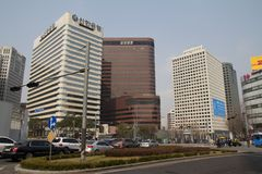Downtown of Seoul. View of one of the streets in downtown of Seoul with moving cars and people Royalty Free Stock Photos