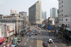 Downtown of Seoul. View of one of the streets in downtown of Seoul with moving cars and people Stock Images
