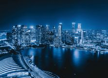 Downtown Singapore City in Marina Bay area. Financial district a. Nd skyscraper buildings. Aerial view at night royalty free stock photography