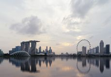 Downtown Singapore city in Marina Bay area with reflection. Financial district and skyscraper buildings at sunset. stock photos