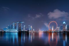 Downtown Singapore city in Marina Bay area with reflection. Financial district and skyscraper buildings at night. royalty free stock photography