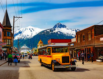 Downtown Skagway. Ketchikan, AK, USA - May 24, 2016: Downtown Skagway bustles with cruise passengers enjoying the natural beauty and the transportation options royalty free stock images