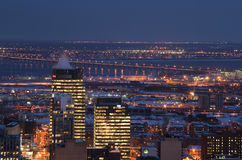 Downtown skyline montreal river bridge night Stock Photo