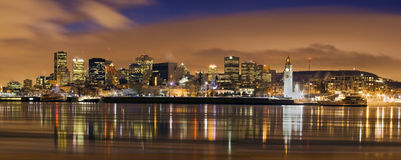 Downtown skyline panorama dusk in Montreal. Downtown panoram skyline  at dusk cityscape night scene Montreal Canada over river Saint Lawrence impressive and Stock Images