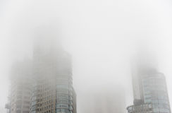 Downtown skyscrapers under the fog Royalty Free Stock Photos