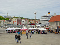 Downtown Stavanger, with market and huge cruise ship Stock Image