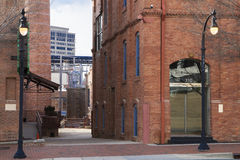 Downtown Street With Brick Buildings and Lamp Post Royalty Free Stock Images
