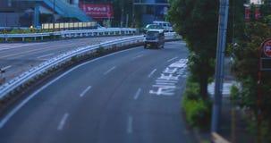 A downtown street at Kanpachi avenue in Tokyo daytime tilt-shift. A downtown street at the avenue tilt-shift. Setagaya district Tokyo Japan - 08.16.2019 : It is stock footage