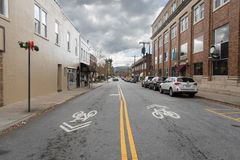 Downtown street in quaint small town with bike lanes royalty free stock images