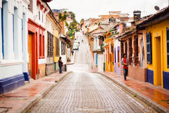 Downtown street up hill with colorful houses Stock Photos