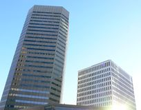 Downtown Structures. Office buildings in Winnipeg, with the sun reflecting off a window royalty free stock image