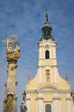 Downtown Szekszárd. Catholic monuments reach to the sky on the main square of the town Szekszárd in South-West Hungary royalty free stock photography