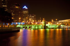 Downtown Tampa at Night. A street level shot across the water looking into downtown Tampa, FL and the new colored lights installed under the bridges Stock Photos