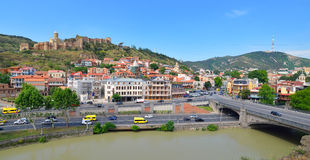 Downtown of Tbilisi. Houses, bridge, river and Narikala fortress on the hill in the downtown of Tbilisi. Georgia Royalty Free Stock Photography