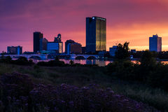 Downtown Toledo, Ohio. A view of downtown Toledo, Ohio and the Maumee River at sunset Stock Photos