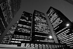Downtown Toronto at night. Looking up at tall skyscrapers in a dark night Stock Photo