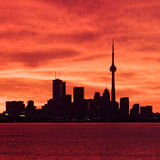 Downtown Toronto waking up to a fiery sky Royalty Free Stock Photos