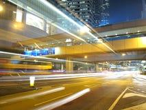 Downtown Traffic at Night. Light traffic strips in Hong Kong at night Stock Photos