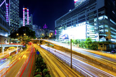 Downtown traffic at night in modern city Stock Images