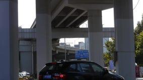 Downtown traffic,under overpass in Beijing. This is downtown traffic,under overpass in Beijing stock video footage