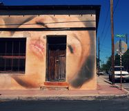 Downtown Tucson. Woman in seductive pose on wall of building royalty free stock photos