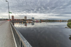 Downtown Umea, Sweden. And its river with a cloudy sky Stock Photo