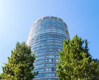 DOWNTOWN VANCOUVER, BC, CANADA - JUNE 30, 2015: The Palisades apartment building between two trees in Downtown Vancouver stock photo
