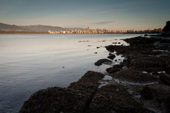 Downtown Vancouver from Jericho Beach, evening stock photo