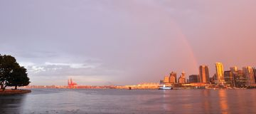 Downtown vancouver with rainbow at sunset stock images
