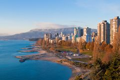 Downtown vancouver at sunset. Downtown vancouver scenic view with mountains and blue sky Stock Image