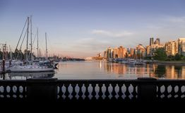 Downtown Vancouver at sunset viewed from Coal Harbour. royalty free stock photos