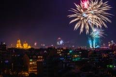 Downtown Varna cityscape with many flashing fireworks celebratin Royalty Free Stock Photo