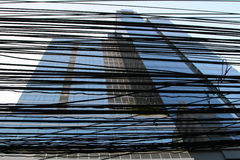 Downtown view in Bangkok, Thailand. Millions of cables are dazzled in front of business center Stock Photography
