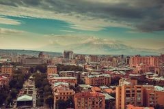 Downtown Yerevan cityscape. Travel to Armenia. Tourism industry. Mount Ararat on background. Cloudy sky. Armenian architecture. Ci Royalty Free Stock Image