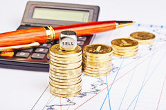 Downtrend coins stacks, calculator, pen and dices cube Stock Photo