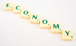Downturn in the economy. A concept images showing the letters comprising the word economy swinging downwords in a curved path. The shape implies a downturn seen Royalty Free Stock Image