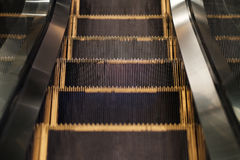 Downward escalator steps Stock Photography