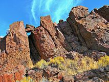 Downward. Leaning red rocks at Jasper Rocks in the Crooked River National Grassland - near Culver, OR stock photos