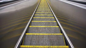 Downward movement standing on an empty escalator stock video
