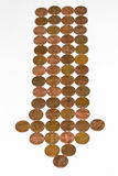 Downward trend in pennies. A downward pointing arrow of pennies symbolizing the falling worth of money Royalty Free Stock Photography