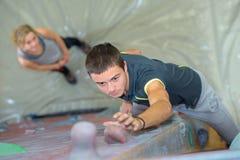 Downward view boy on climbing wall. Downward view of boy on climbing wall stock images