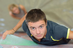Downward view man on climbing wall. Downward view of men on climbing wall royalty free stock photo